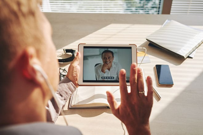telehealth video conference on tablet with speech therapist